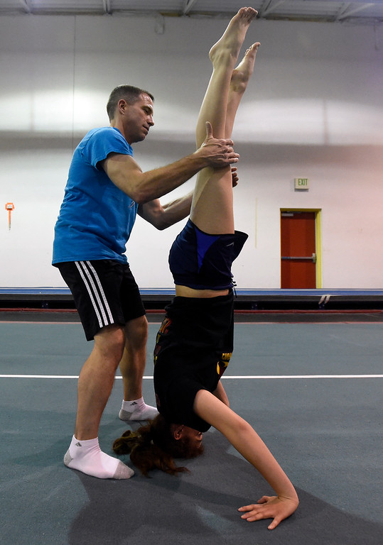 . Instructor Gary Weiland helps Angelique Peterson with her form as she works out at an Airborne Gymnastics workout class on Thursday at Airborne Gymnastics in Longmont. For more photos of the class go to www.dailycamera.com Jeremy Papasso/ Staff Photographer/ March 23, 2017