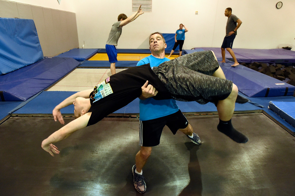 . BEST 1. Instructor Gary Weiland helps Alex Olson with his back handspring form as he works out at an Airborne Gymnastics workout class on Thursday at Airborne Gymnastics in Longmont. For more photos of the class go to www.dailycamera.com Jeremy Papasso/ Staff Photographer/ March 23, 2017
