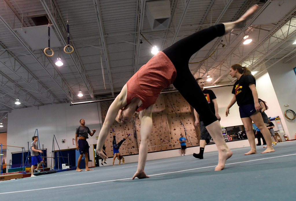 . Kelsey Schlarman, at center, works out at an Airborne Gymnastics workout class on Thursday at Airborne Gymnastics in Longmont. For more photos of the class go to www.dailycamera.com Jeremy Papasso/ Staff Photographer/ March 23, 2017