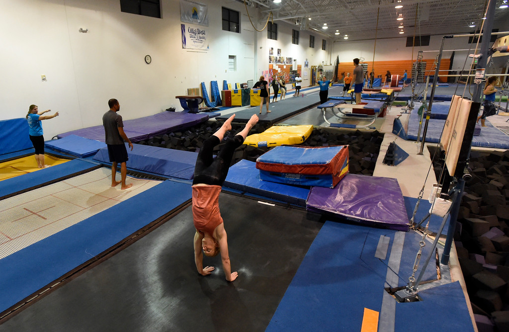 . Kelsey Schlarman does a back handspring on the trampoline as she works out at an Airborne Gymnastics workout class on Thursday at Airborne Gymnastics in Longmont. For more photos of the class go to www.dailycamera.com Jeremy Papasso/ Staff Photographer/ March 23, 2017
