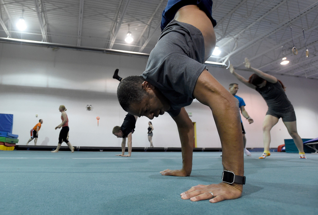 . Craig Foster, at center, works out at an Airborne Gymnastics workout class on Thursday at Airborne Gymnastics in Longmont. For more photos of the class go to www.dailycamera.com Jeremy Papasso/ Staff Photographer/ March 23, 2017