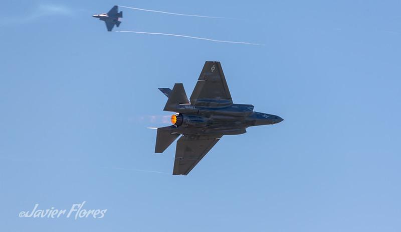 Two Lockheed Martin F-35 Lightning II with afterburner