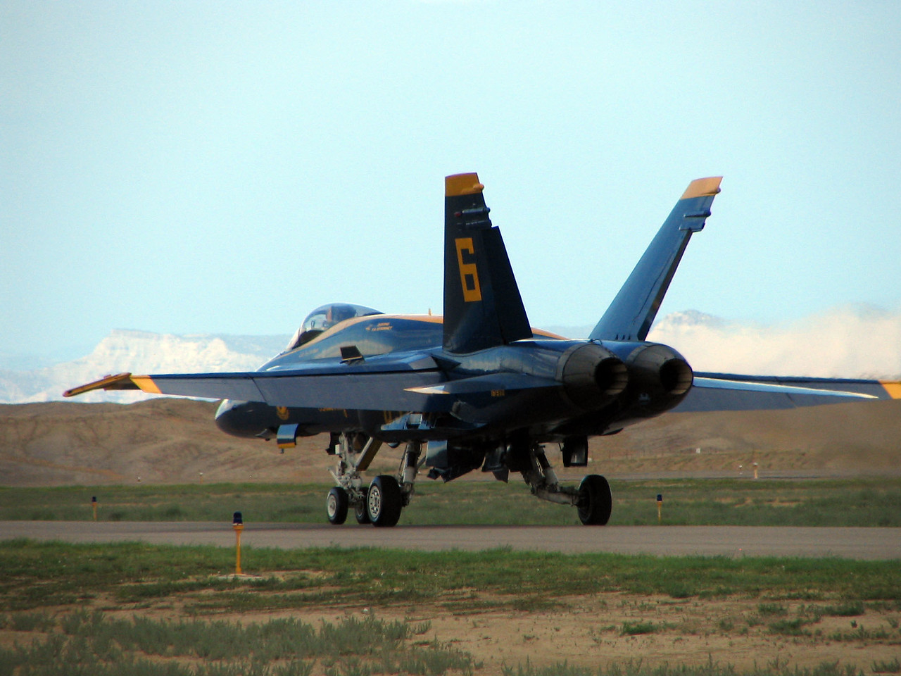 Blue Angel #6 taxies out to the far end of the runway prior to takeoff
