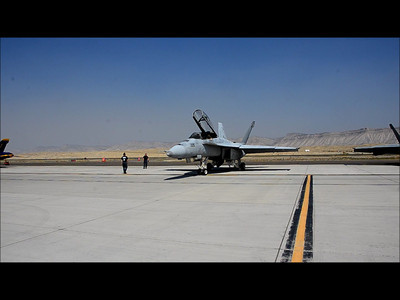 """I posted this over at the US Navy's TAC DEMO Page too, thought the Boys and Girls of VFA-106 """"The Gladiators"""" (the east Coast's F/A-18 Fleet Replacement Squadron and home of the F/A-18 Flight Demonstration Team) would get a kick out it. (A thanks goes to Ken Schoeni for a couple of the stills of my """"Yard Sale"""")... Here's the story...  While photographing the Grand Junction Airshow Practice on Friday for Tailhook, I thought I'd try my hand at a little videography. As you will see... that didn't work out too well...   """"Neon"""" and """"Rooney"""" are the crew for the first """"go"""". Their crew chief directed them out for what was to be a """"Right Turn Out""""... Woulda been fine with me... What none of us expected was the 170 degree right turn! As I was filming, I realized in a classic """"Ahhhhh Craaaap"""" moment that the Blowers were about to point right at me, just as the """"Need for Speed"""" - (Taxi Speed anyway) came upon the crew. Lemme tell ya, that zephyr is hot! And quite gusty!   I maintained my stance amazingly enough (well, I took a knee actually!), but the VIP folding chairs behind me got blasted all over the Grand Junction Apron! Oh and so did the rest of my camera gear including 2 lenses that happened to be sitting on one of the now """"Gone With the Wind"""" chairs!  The video captures (amateur as it is...) the initial taxi, the turn , and then some stills of the after... The video concludes with stills from the debrief where 'Neon' and 'Rooney' are told of the carnage.  Ah well, the hazards of Naval Aviation! Enjoy :-) — at Grand Junction Air Show."""