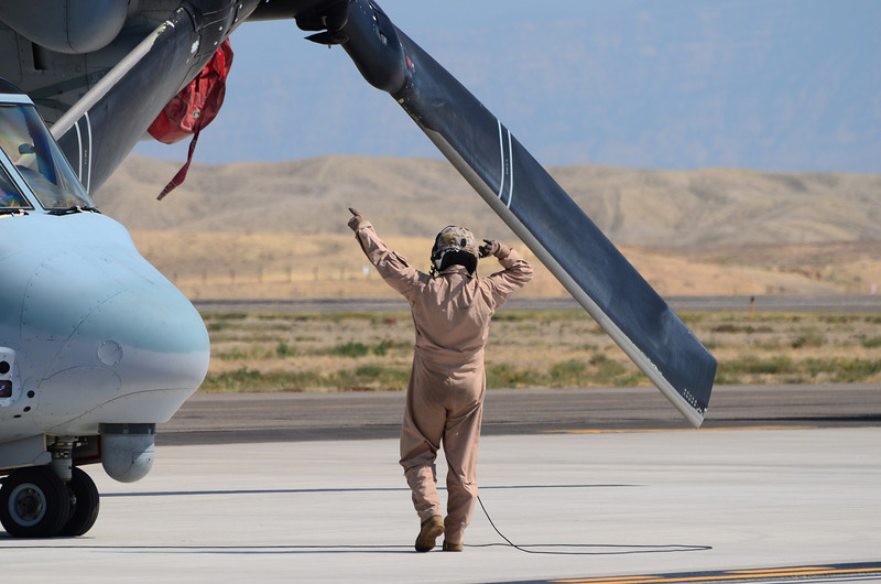 Sea Elks' Crew Chief calls for preparation of the V-22 for the day's rehearsal demo.