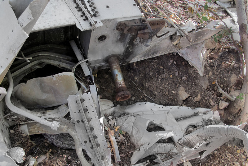 On the center section, there was the pivot for the right landing gear and just above it, the fitting which locks the gear in the down position. Looks like after someone removed the landing gear, they replaced the nut on the pivot shaft.