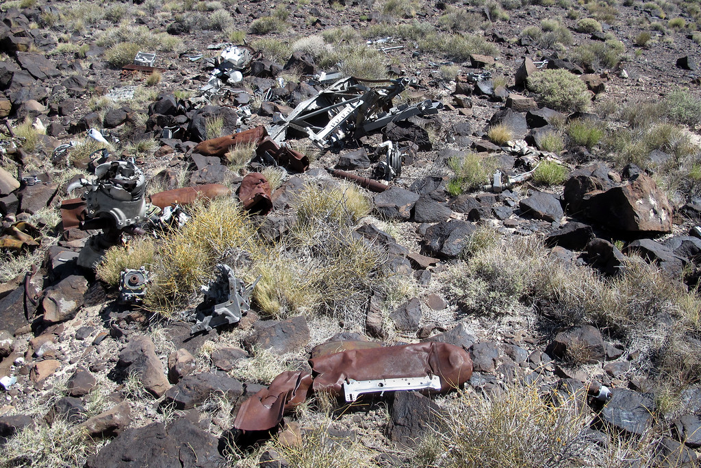 Over all view of the wreckage in this area before heading down the slope to where the bomber first struck the mountain.