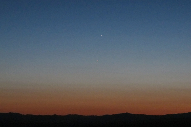 This photo was taken from our camp site back at the Queen Mine. What look like three stars are actually the planets of Jupiter on the left, Venus at the bottom and Mercury on top about one hour after sunset above the Sierra Mountains.