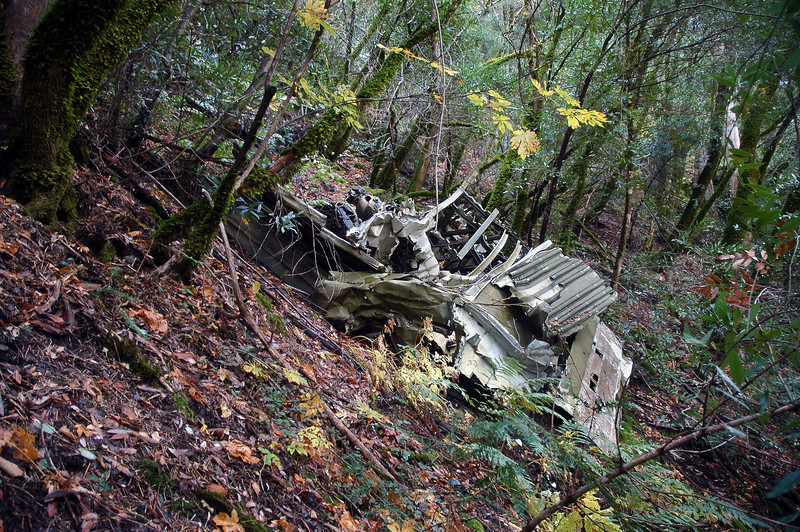 After finding a place where we could regain about four hundred feet of altitude, we came upon the first piece of wreckage.