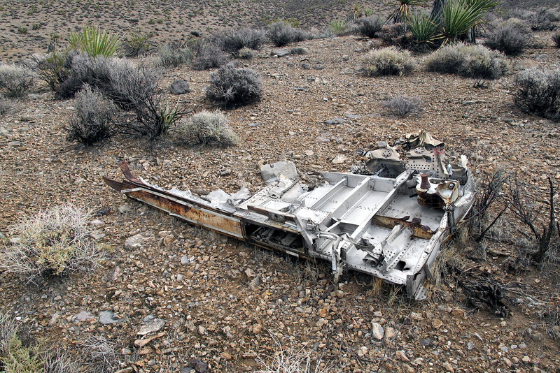 Piece of the keel that runs down the center between the engines. An engine mount can be seen. Like a lot of widely scattered wreckage at this site, it sits alone with no other wreckage in sight.