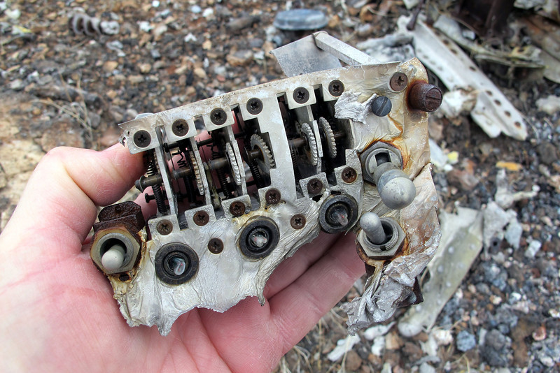 This looks like part of the IFF control panel. What I found interesting was the three light bulbs that collapsed due to the vacuum inside them when the glass was soften by the heat from the post crash fire.
