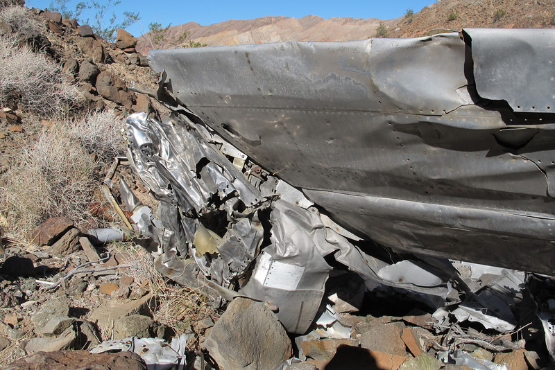 Underneath was the mangled remains of the tail end of the fuselage.