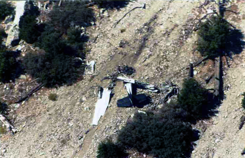 This aerial photo of the crash site appears to be taken shortly after the site was found with the wreckage in a fairly undisturbed state. The wreckage is still all in one group like the NTSB report stated. <br /> <br /> Photo provided by John Markley