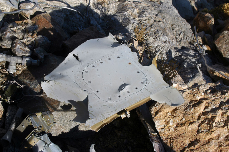 A piece from the fuselage with an access cover.