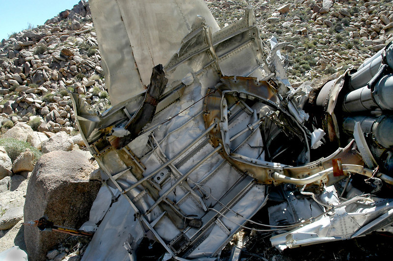 This is a section of fuselage that is peeled back from the engine.