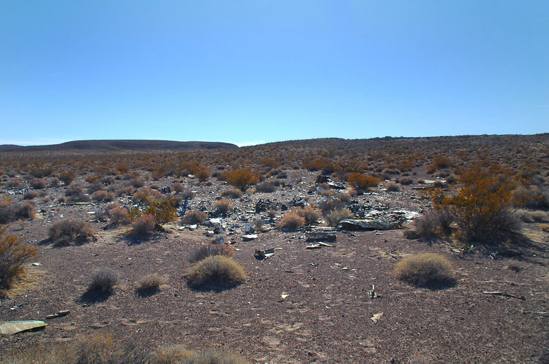 Looking at the impact crater and the debris  that are scattered for a hundred yards beyond.