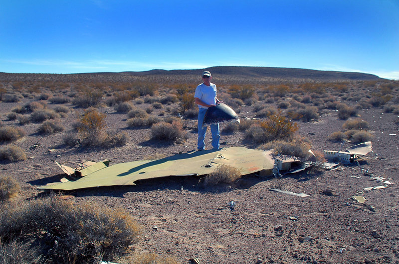 This is most of the left wing which was the largest piece at the site. I'm holding a piece of the nosecone.