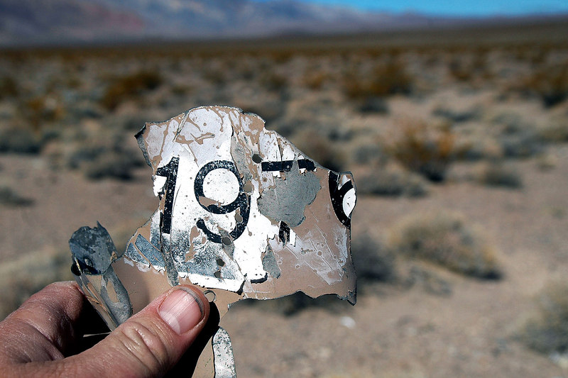 About an hour later found another piece. Looks like it's a US Bicentennial sticker. The whole time I been looking for something I can ID this plane with. So far can tell it crashed in 1976 or after.