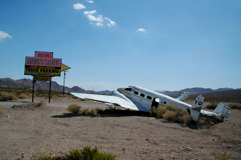 The C-45 crashed while landing at the Fran's Star Ranch's private landing strip. The ranch later became Angel's Ladies.