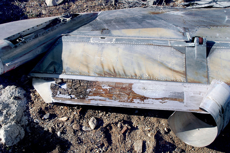 A section of skin was pealed away from the rudder exposing the end gained balsa wood core. The rudder linkage can also be seen in this shot.