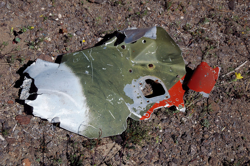 Piece of sheet metal. Looks like the Sabre was painted in camouflage. Was finding orange marking on a lot of the wreckage.