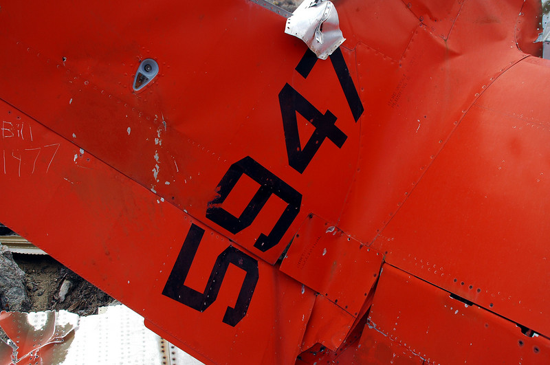 Tail number. On the other side where the paint was gone, I could see part of an old faint number, 636...