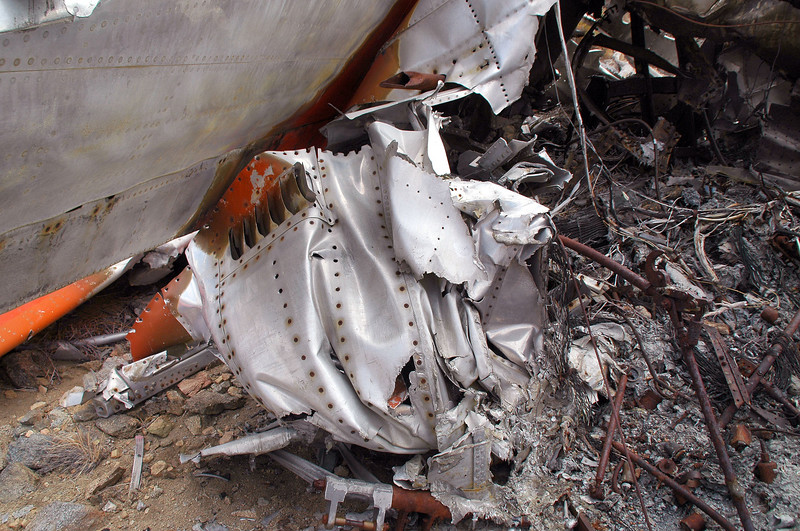 Crushed piece from the fuselage. Think this is from above the engine intake.