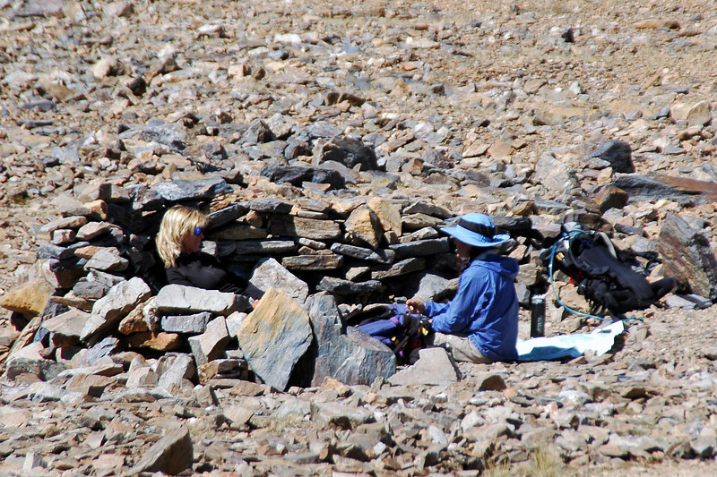 When I got to the pass at 12,000 feet, found Sooz and Cori taking a break in a rock shelter. The wind was blowing hard at the pass.