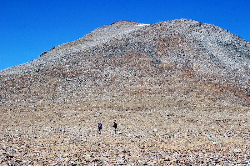 Cori and Sooz with the 13,000 foot peak that we have to hike over. We left the trail here to climb up the east slope.