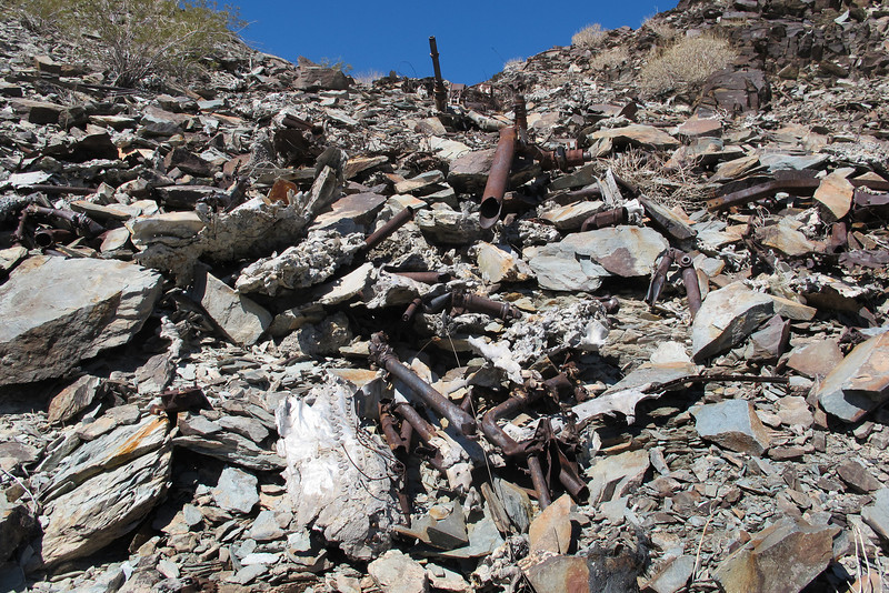 At the bottom of a large group of wreckage near the top of the slope.