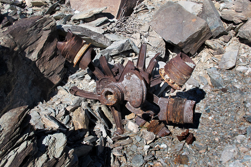 The remains of another engine. This one has most of the connecting rods and some pistons and cylinders attached to the crankshaft.