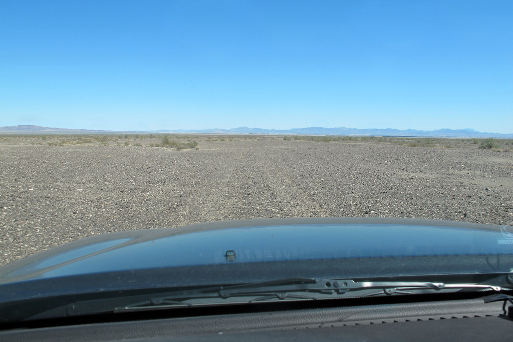 Crossing open desert while heading out towards the highway. This turned out to be a great site with a lot of interesting pieces of wreckage remaining. <br /> <br /> THE END