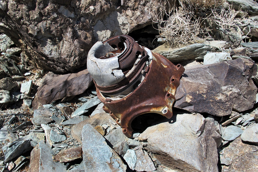 Part of a prop hub. The wreckage I've come upon so far has been scattered along the canyon bottom, it must lead to the impact area farther up the canyon.