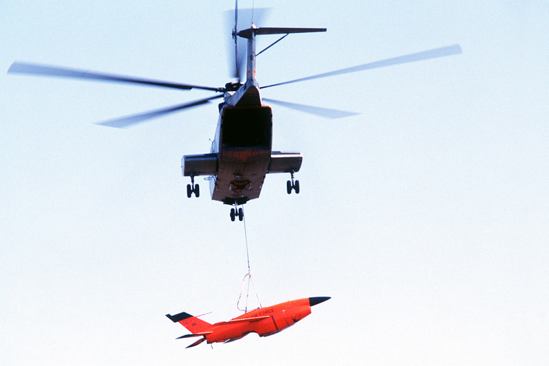A CH-3 Sea King helicopter recovering a Firebee drone. This one lives to fly other day.<br /> <br />  THE END