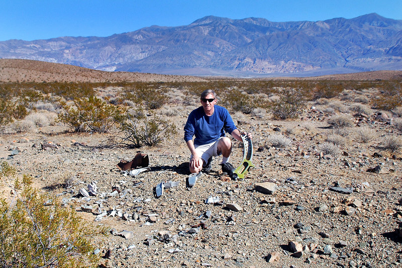Me at the impact site. I'm holding the largest piece at the site. Telescope Peak is the mountain behind me.
