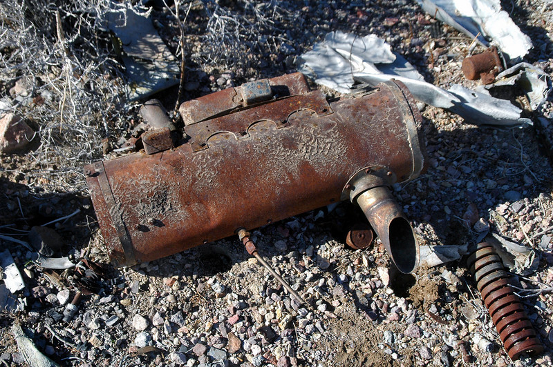 Looks like a muffler, but it's to small for the engines on this plane. The NTSB report stated that the plane was transporting a spare engine, wonder if the muffler is from that engine???