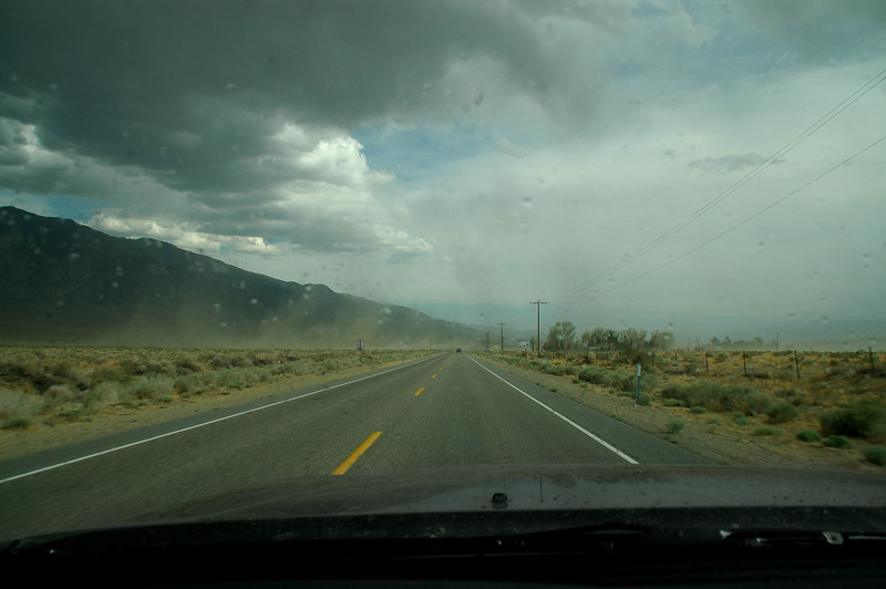 On Hwy 6 heading towards Bishop. Up ahead to wind blowing across the road at over 40 mph. It's also starting to rain with a outside temperature of 95 degrees. It's the time of year for thunder storms in this area. <br /> <br /> THE END