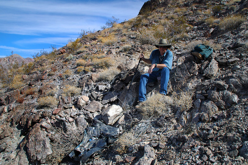 Tom sitting on the edge of the impact crater.