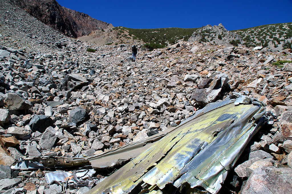 The wreckage is in a gully that has a series of steps.