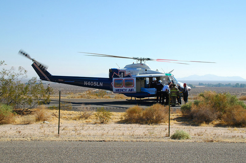 On 10/15/06 I took this photo of a Mercy Air crew picking up a driver who rolled his SUV on Hwy 395 just north of Indian Wells.
