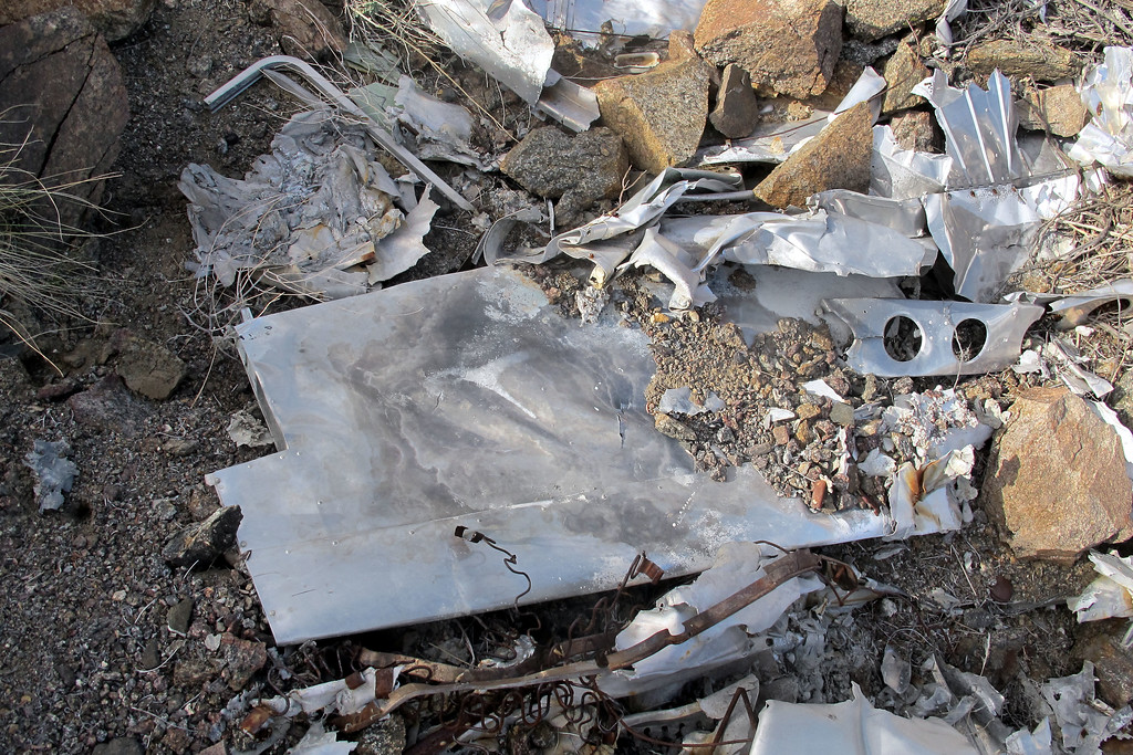A section of the horizontal stabilizer was sticking out from under the pile of rocks and wreckage.