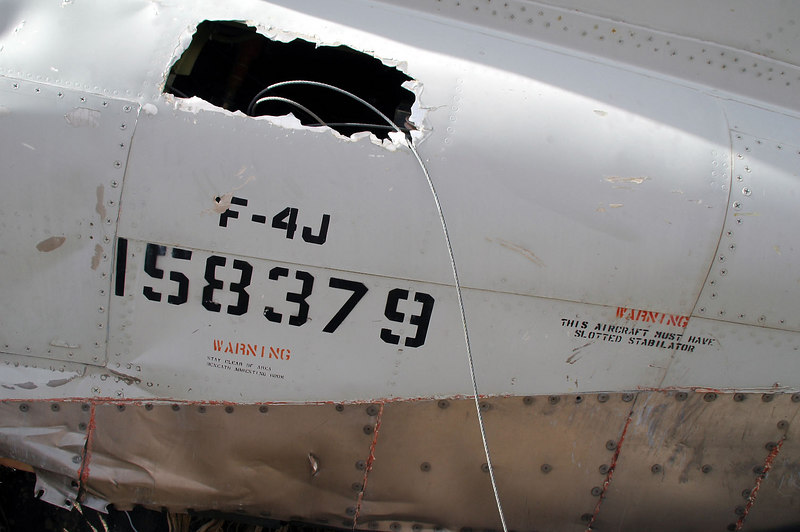 Looks like someone made this hole and a few others in the fuselage.