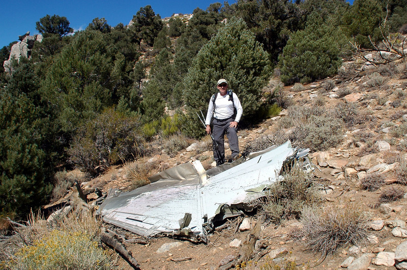 Me with the wing section.<br /> <br /> The wreckage of this plane was scattered up the slope, looks like there's a lot of stuff here.