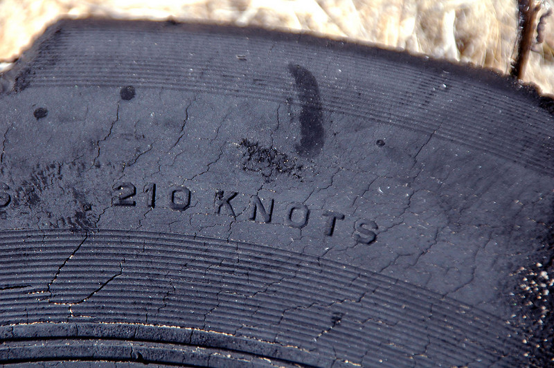 It was small and had a speed rating of 210 knots, looks like it's a nose wheel from a jet.