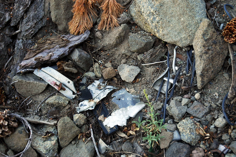 Looking around, I was only finding small pieces of wreckage and remains of the cable the plane was carrying as cargo.