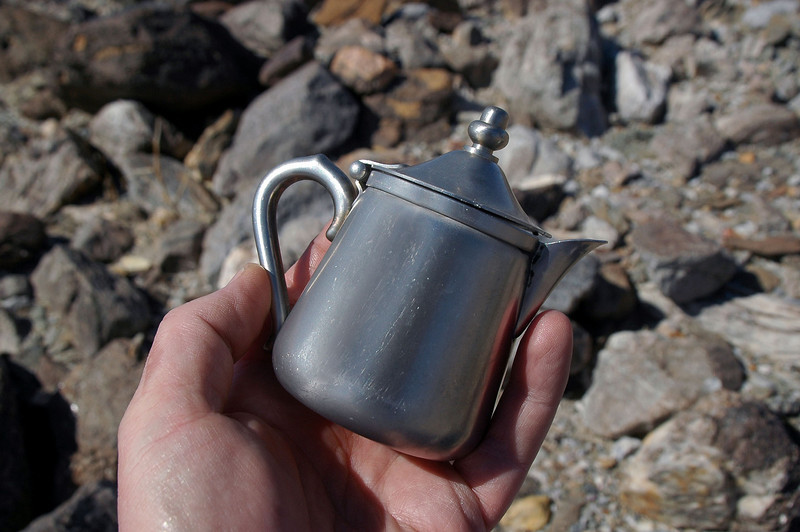 After hiking for about 15 minutes, I saw something that looked like stainless steel in the rocks. Thought it was a piece of aircraft wreckage. Turned out to be a little pot. Usually get fooled by a beer can or balloon. No idea how this would have gotten out here.