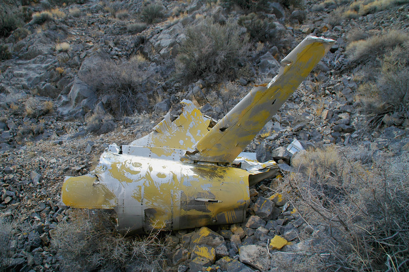 It has the lower half of the fin and one of the stabs still attached. The control surfaces are gone. Lot of yellow paint to mark it as a known crash site.