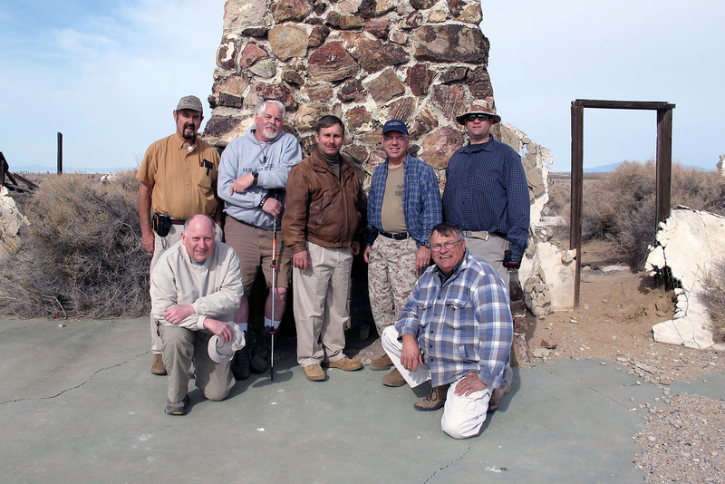 Group shot in front of the fireplace before heading out to check out some crash sites.