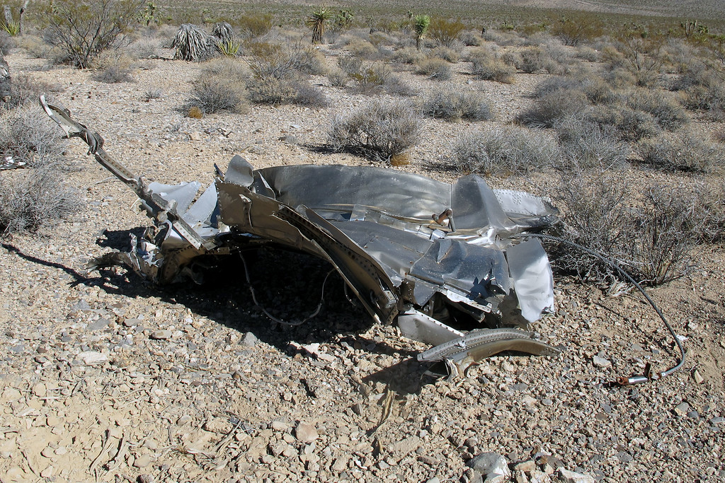 This is a large piece, about six feet across. It from the aft end of the fuselage. It has a heavy cable attached to it.