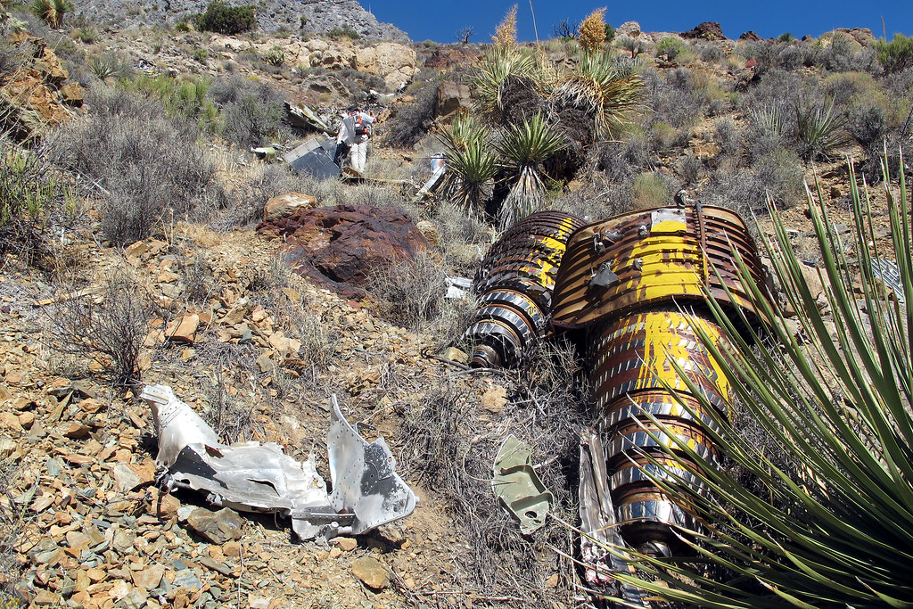At the crash site. Wreckage of the F-4 was scattered for about 200 feet, contained in a ravine. The compressor rotors from both engines and a piece from one of the ejection seats are seen in this photo.